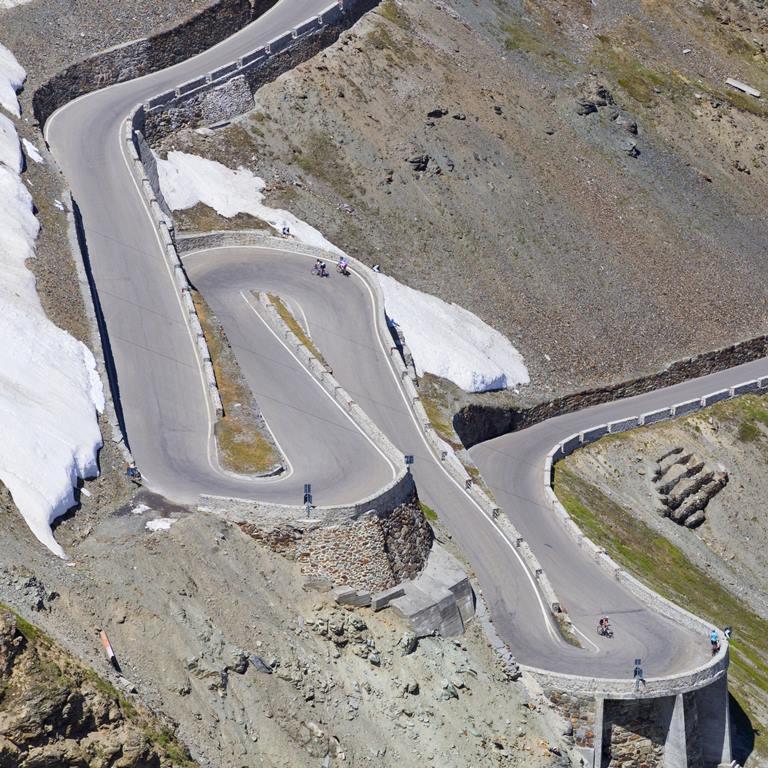 Road at Passo dello Stelvio, Vinschgau, South Tyrol, Italy / serpentines
